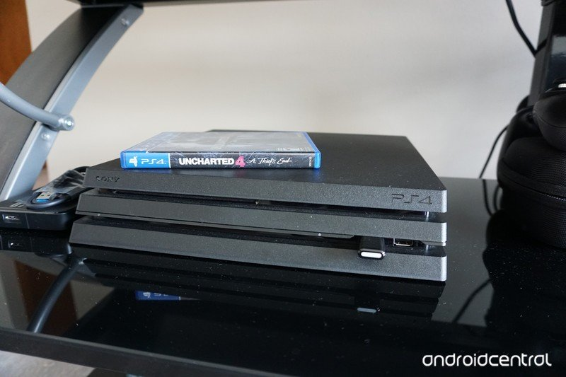 PlayStation 4 Pro on entertainment stand